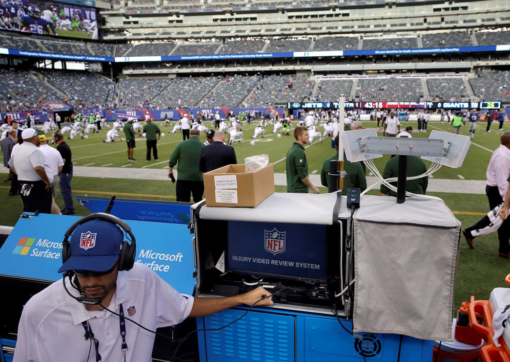 An NFL employee sets up a video review system used to help spot injuries on the field during NFL games. In 2015, the NFL gave ATC spotters in the press box the power to call a medical timeout. (AP Photo/Seth Wenig)