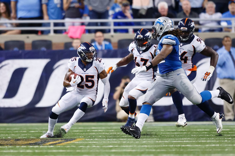 Denver Broncos cornerback Chris Harris runs the ball after a blocked extra point attempt against the Detroit Lions. (AP Photo/Rick Osentoski)