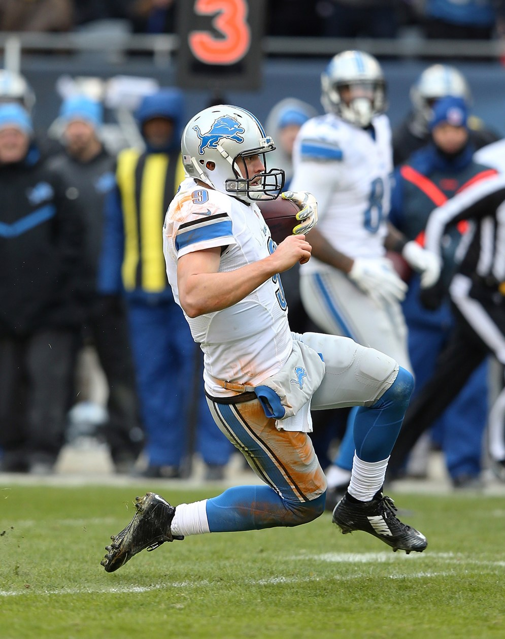 Lions quarterback Matthew Stafford slides safely in a 2015 game against the Bears. NFL officials in 2016 will make sure that once a runner begins a feet-first slide before contact is imminent, defenders cannot make any forcible contact and must treat the sliding runner as they would any runner who is down by contact. (Paul Spinelli via AP)
