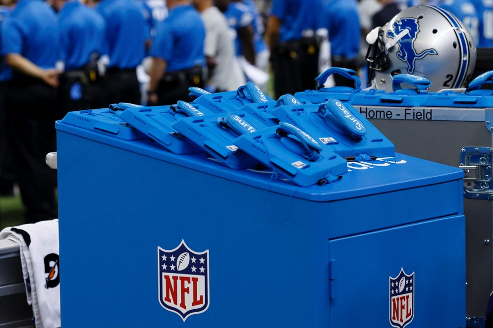 Microsoft Surface tablets on the sideline during an NFL football game between the Detroit Lions and the New York Giants at Ford Field in Detroit, Monday, Sep. 8, 2014. (AP Photo/Rick Osentoski)