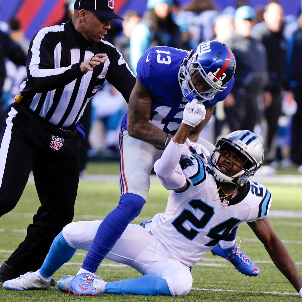 Carolina Panthers cornerback Josh Norman and New York Giants wide receiver Odell Beckham, Jr. square off in a week 15 game during the 2015 NFL season. Norman was fined $26,044 for personal foul penalties and Beckham, Jr. was suspended for one game. (Evan Pinkus via AP)