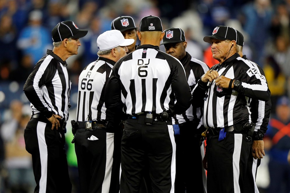 Officials gather during an NFL game. (AP Photo/Wade Payne)