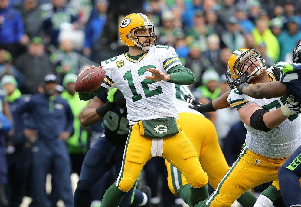 Green Bay Packers quarterback Aaron Rodgers throws a pass during the NFC Championship game against the Seattle Seahawks at CenturyLink Field on Sunday, January 18, 2015 in Seattle, WA. (AP Photo/Todd Rosenberg).