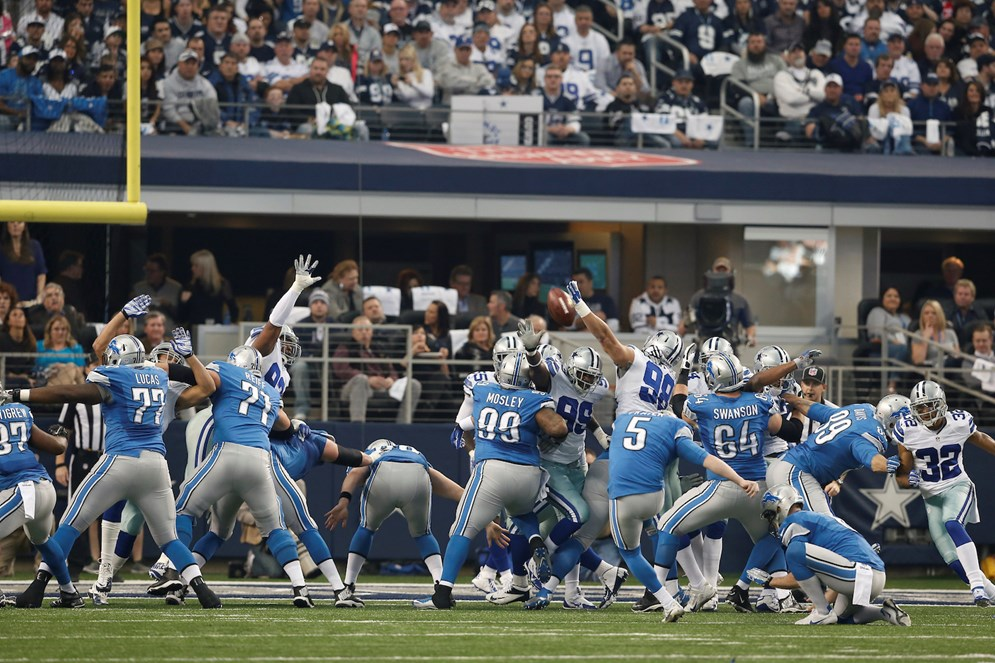 Detroit Lions kicker Matt Prater kicks an extra point after a touchdown against Dallas in the Wild Card Round of the 2014 NFL playoffs. (AP Photo/Brandon Wade)