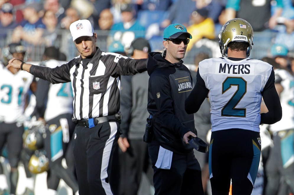 Jacksonville Jaguars kicker Jason Myers walks to the bench after missing an extra point in the second half of a game against the Tennessee Titans. (AP Photo/James Kenney)