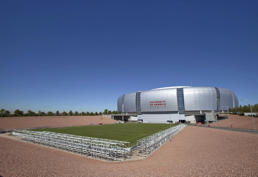 The retractable playing field is shown outside University of Phoenix Stadium, Tuesday, Oct. 11, 2011, in Glendale, Ariz. (AP Photo/Matt York)