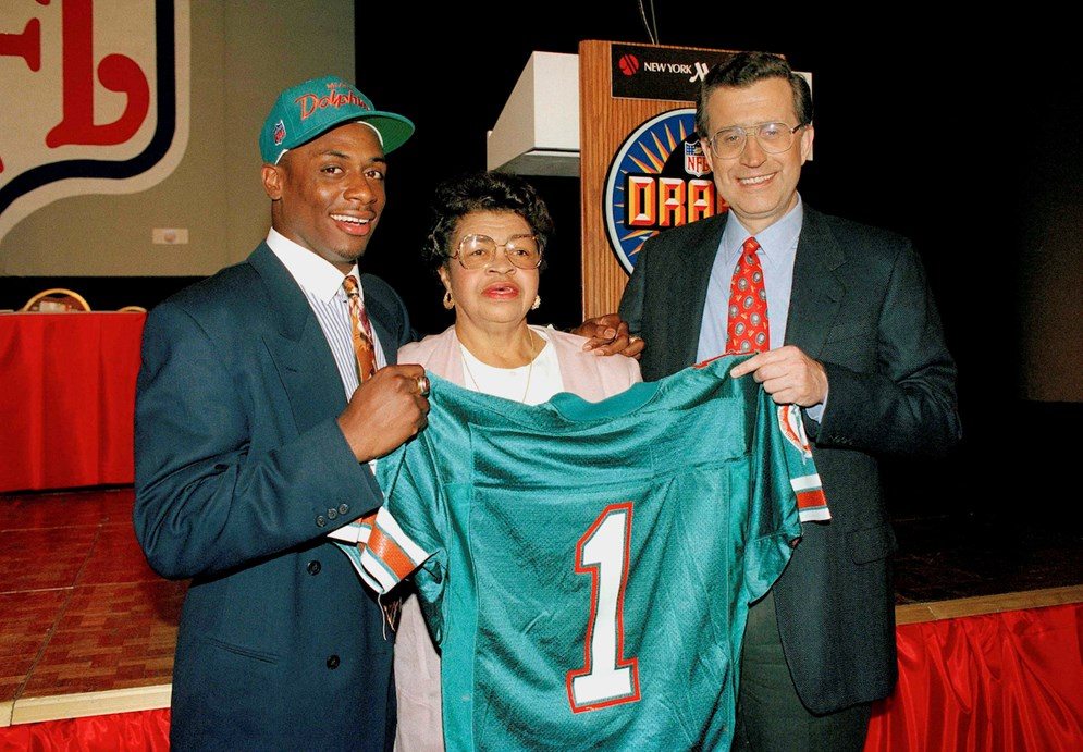 NFL Executive Vice President of Football Operations Troy Vincent poses with his grandmother Julia and former NFL Commissioner Paul Tagliabue after he was selected out of Wisconsin with the seventh pick in the first round of the NFL Draft by the Miami Dolphins in April, 1992. (AP Photo/Richard Harbus)