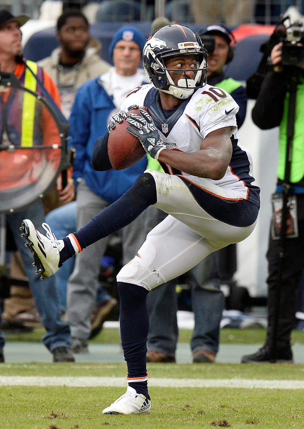 Broncos wide receiver Emmanuel Sanders winds up like a baseball pitcher before throwing the football after scoring a touchdown on a 3-yard run. Sanders was penalized for unsportsmanlike conduct for the celebration. In 2017, players can use the football as part of their celebrations. (AP Photo/Mark Zaleski)