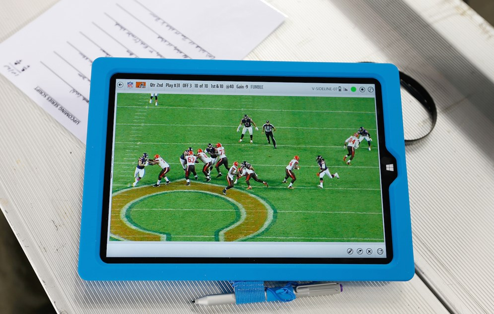 Coaches can use Microsoft Surface tablets to zoom in on high-resolution color images instead of showing players static black-and-white photos. (Scott Boehm via AP)
