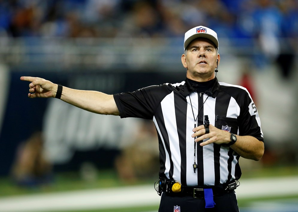 NFL Referee Bill Vinovich makes a call during an NFL football game between the Detroit Lions and the Chicago Bears on Thursday, Nov. 27, 2014 in Detroit. (Jeff Haynes/AP Images for Panini)