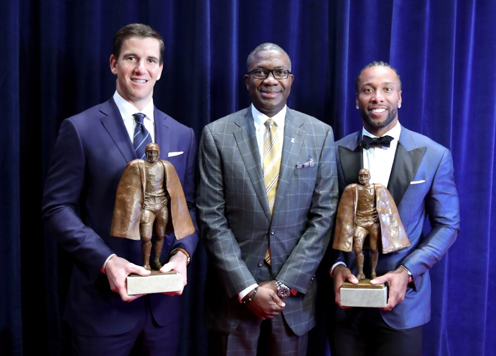 Giants quarterback Eli Manning and Cardinals wide receiver Larry Fitzgerald received the Walter Payton Man of the Year Award at the 6th annual NFL Honors in Houston ahead of Super Bowl LI. (Ben Liebenberg via AP)