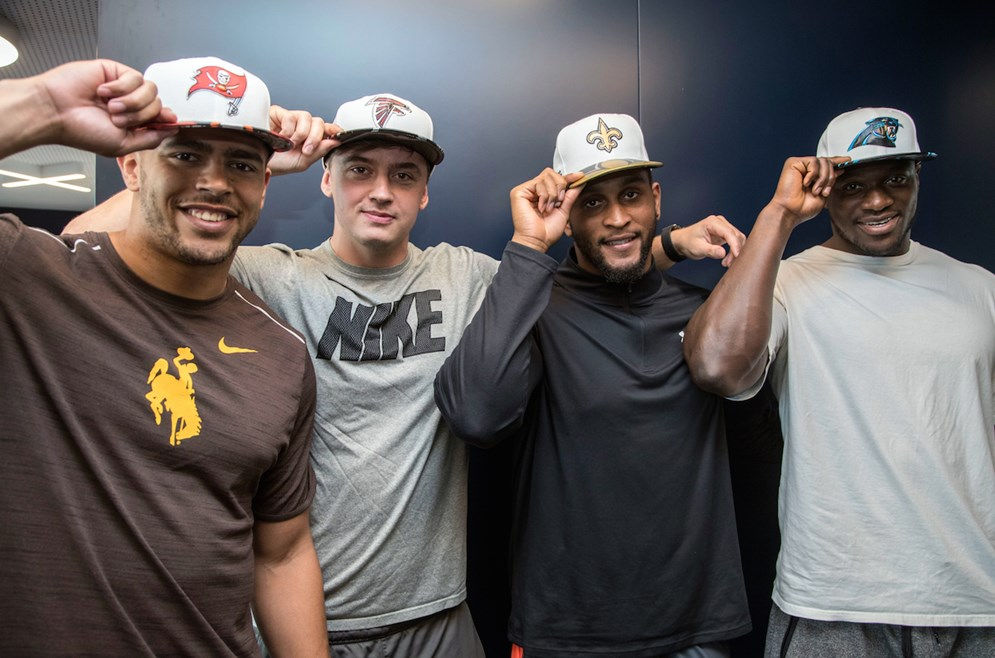 (L-R) Linebacker Eric Nzeocha, tight end Alex Gray, defensive end Alex Jenkins, and defensive end Efe Obada pose for a photo after being selected by the Tampa Bay Buccaneers, Atlanta Falcons, New Orleans Saints and Carolina Panthers as part of the 2017 International Player Pathway Program on Wednesday, May 24, 2017 in London. (Jed Leicester via AP)