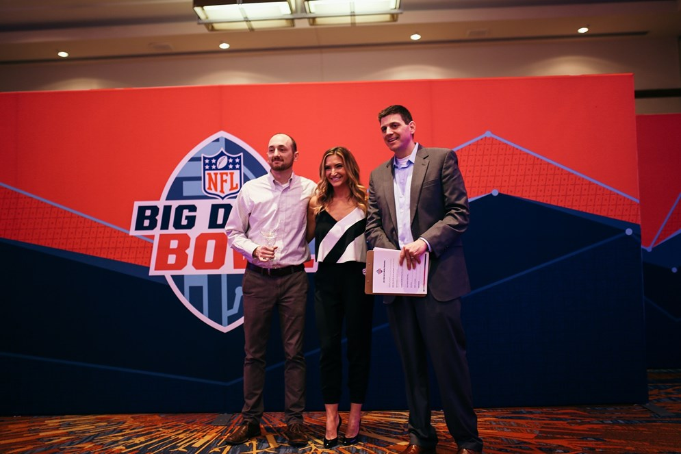 Open entry winner Nathan Sterken with emcee Cynthia Frelund and Mike Lopez, the NFL's Director of Football Data and Analytics