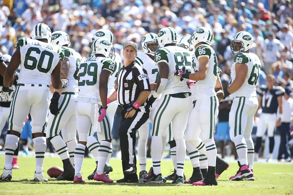 Umpire Carl Paganelli takes his position in the offensive backfield during a 2014 NFL game between the San Diego Chargers and the New York Jets. Starting in 2015, umpires will remain in the offensive backfield on plays inside the defense's 5-yard line moving toward the end zone. (AP Photo/Tom Hauck)
