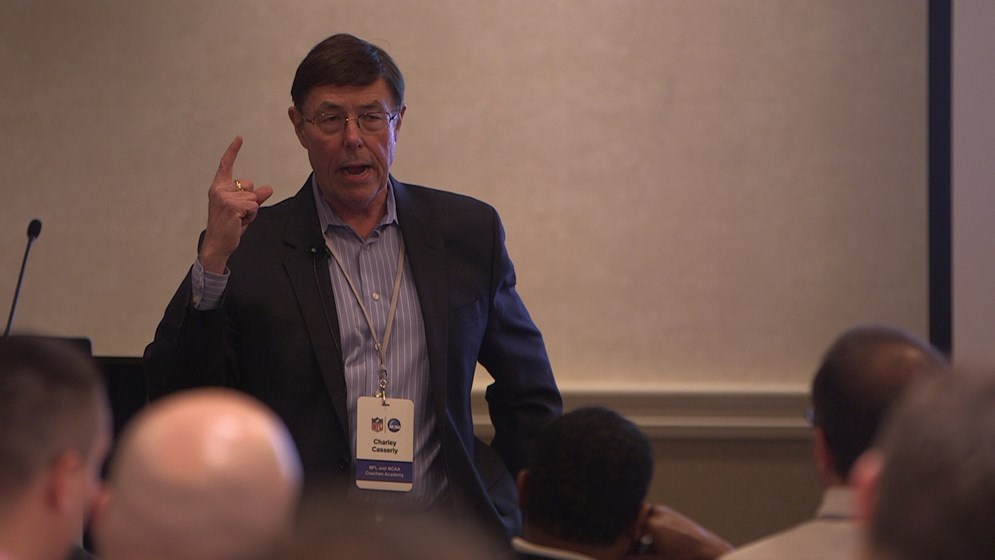 Charley Casserly, NFL Network analyst and former NFL general manager addresses attendees at the 2014 NFL-NCAA Coaches Academy.