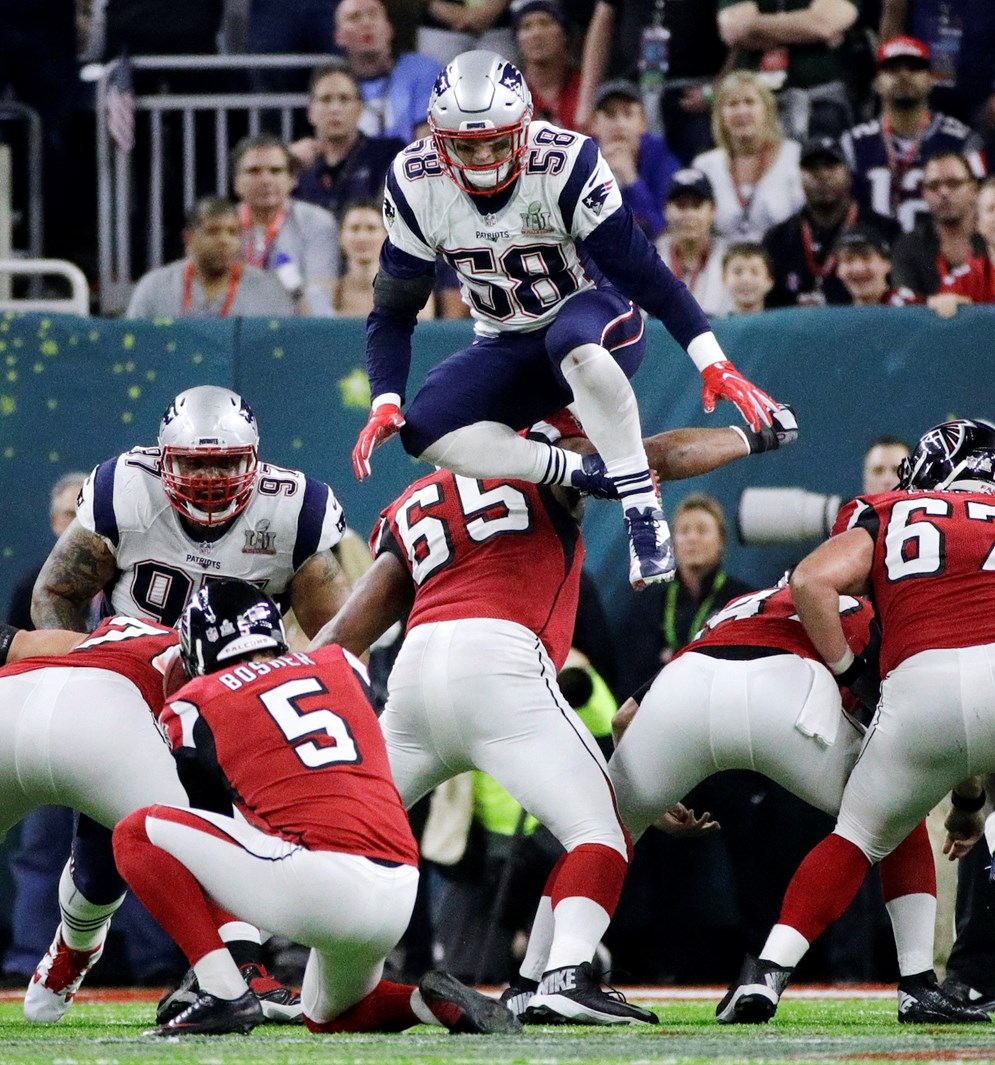 The Patriots' Shea McClellin leaps over the line of scrimmage in an attempt to block a kick during Super Bowl 51. In 2017, NFL owners voted to prohibit running toward and leaping across the line of scrimmage in an obvious attempt to block field goal or extra-point kicks. (AP Photo/Jae C. Hong, File)