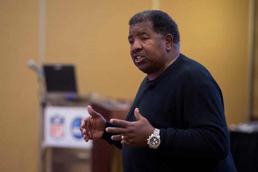 Former Vikings head coach Dennis Green stresses the value of football to 2015 NFL-NCAA Coaches Academy attendees.