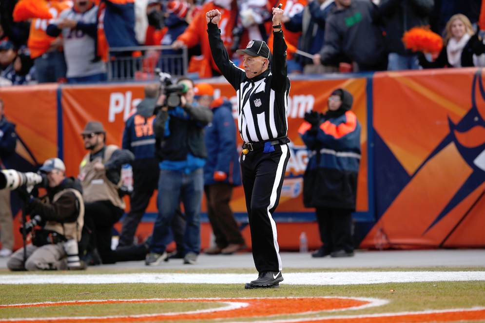 Back Judge Tony Steratore signals a successful field goal during the NFL AFC Championship playoff football game between the New England Patriots against the Denver Broncos, Sunday, Jan. 24, 2016, in Denver. (Scott Boehm via AP)
