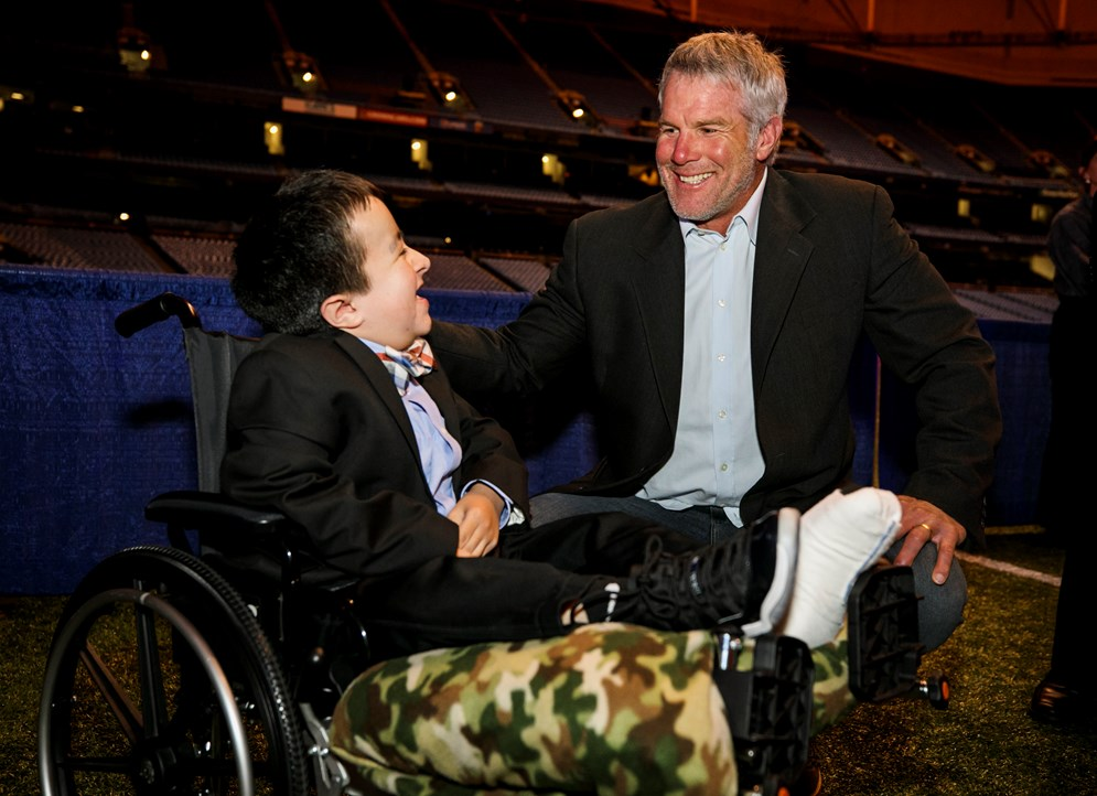 Alec, a patient at Shriners Hospitals for Children, with 1991 East-West Shrine Bowl alumni Brett Favre.
