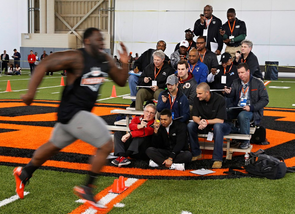 Scouts clock a college player's time in the 40-yard dash. (AP)