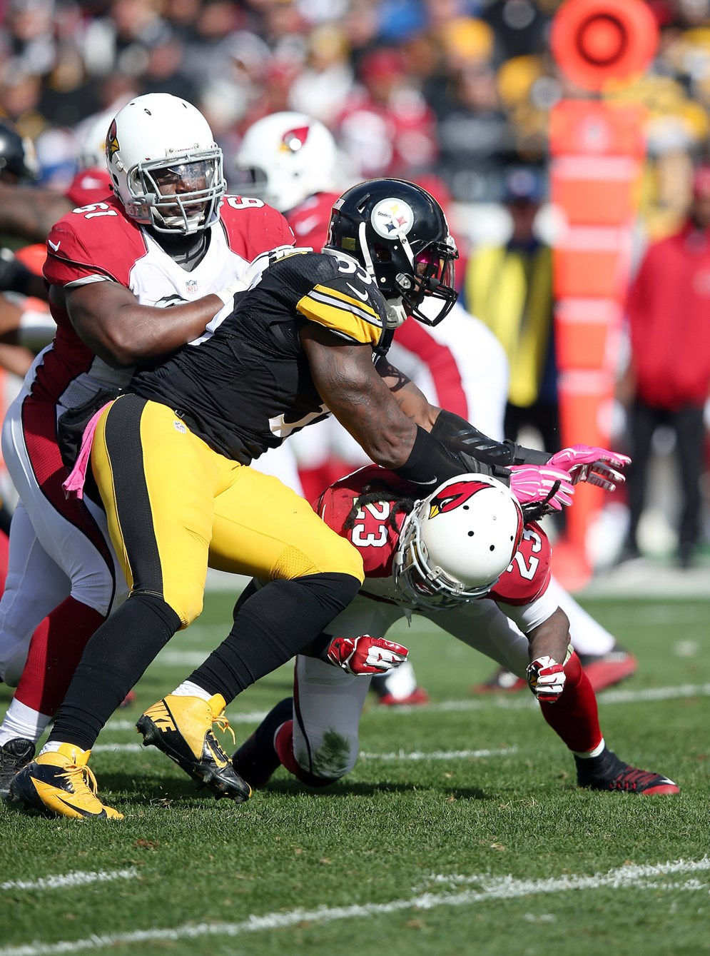 Pittsburgh Steelers outside linebacker Arthur Moats works his way through an illegal chop block in a game against the Arizona Cardinals. The NFL Competition Committee voted to make all chop blocks illegal beginning in 2016. (Paul Spinelli via AP)