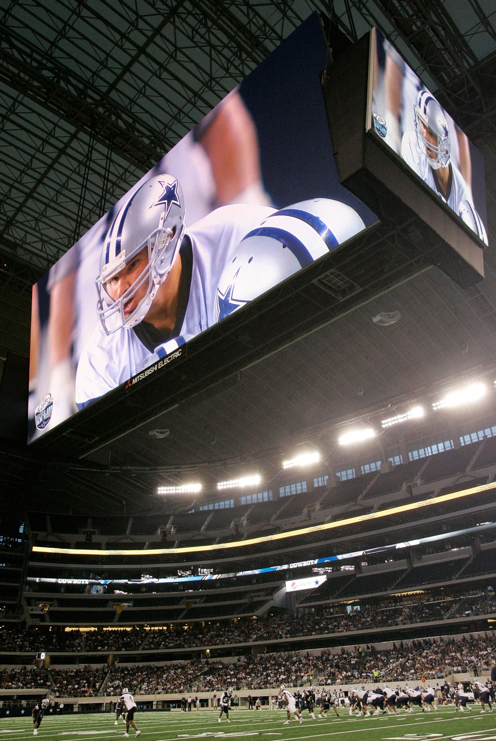 The Dallas Cowboys' high-definition video board is an example of how teams use technology to enhance the game experience. The screen is the equivalent of more than 4,900 52-inch flat-panel TVs. (AP Photo/Tony Gutierrez)