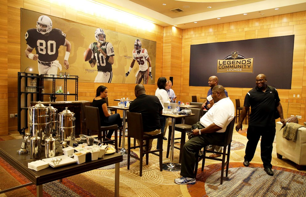 Former NFL players and guests visit in the NFL Legends Community Lounge in Seattle. (AP Photo/Ted S. Warren)